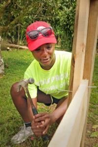 woman building a frame